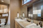 Upper level bathroom with dual vanity, shower/tub combo and bidet
