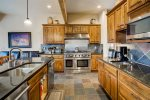 The large gourmet kitchen will delight the chef in your group