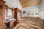 The upper level mater bathroom boasts a jetted tub, 2 vanities, a large walk-in shower and private toilet
