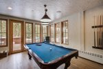 Play a round of pool while watching the snow fall