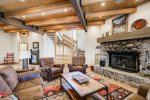 Warm by the large wood-burning fireplace in the main floor living room
