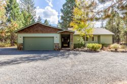 Beautifully remodeled home on naturally landscaped wooded acre lot
