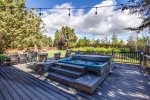 1100 sqft deck to relax on, dining table, lounge chairs and hot tub and bbq.