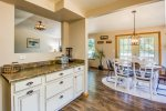 Eat in Kitchen with great lighting and room for everyone.