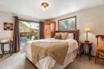Master bedroom with slider that leads to private patio, en suite with walk in shower.