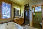 Master bathroom with full size soaking tub and walk in shower.