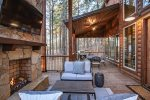 Outdoor deck with fireplace and seating