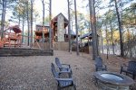 Backyard view with fire pit and play set