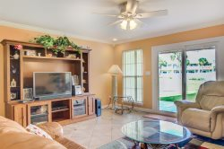 Let the tropical hues lure you into Seacoves 4A, a lovely three-bedroom vacation townhome in Destin, FL.