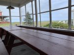 Screened-in porch with ocean views