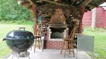 Outdoor fireplace shelter