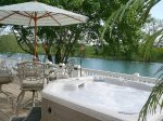 Outdoor Hot tub patio table, umbrella and chairs up river view
