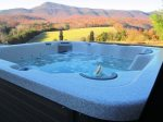 Hot tub by campfire and mountain views
