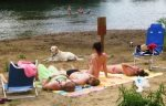 Relax or swim at the sandy riverfront area