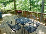Deck with table and chairs and charcoal grill