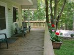 Front covered porch w/ adirondack chairs