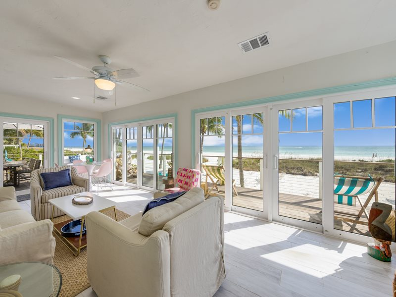 Right on the sand with King Master with ensuite Bath 2 Queens 2 Twins and enclosed porch & Barefoot Bliss | Fort Myers Beach Vacation Rental | Private Pool
