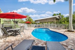 Tropical Oasis 128 with private deck, shared heated pool and dock
