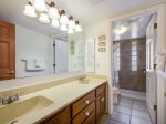 Guest bath behind front king bedroom, twin vanities with new walk-in shower