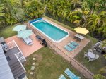 Large 13 x 32 ft. open pool with deck and patio