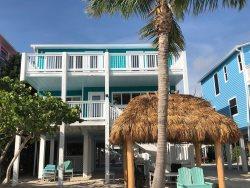 Sugar Beach Mermaids Retreat - Direct Beachfront with Great Sunset Views, private Tiki Hut