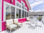 Sugar Beach Direct Beachfront Cottage with Large Gulf View Deck and Shared Heated Pool.