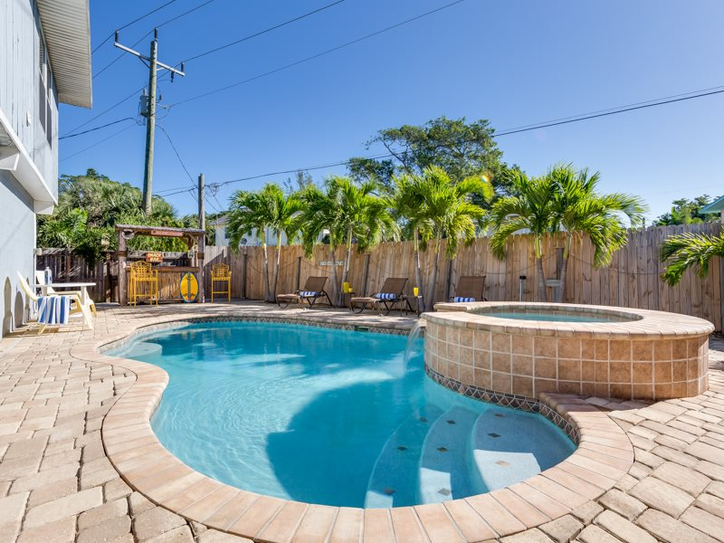 Island Charm Is Your Tropical Pool Home In Paradise