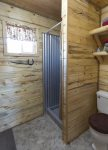 Bathroom features custom metal shower enclosure